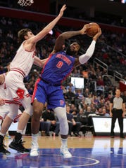 Andre Drummond rebounds against Luke Kornet on Saturday.