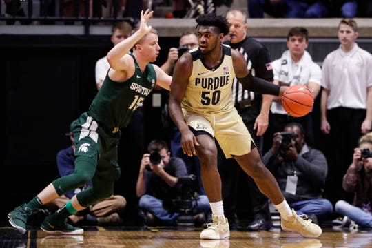 Purdue forward Trevion Williams drives on Michigan State forward Thomas Kithier during the first half on Sunday, Jan. 12, 2020, in West Lafayette, Ind.