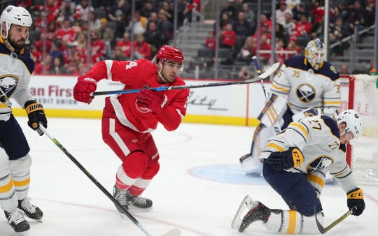 Detroit Red Wings center Robby Fabbri goes for the puck against the Buffalo Sabres during the first period at Little Caesars Arena in Detroit, Sunday, Jan. 12, 2020.