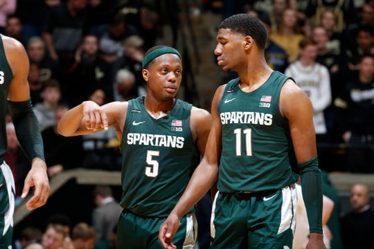 Michigan State guard Cassius Winston, left, talks to forward Aaron Henry during the second half of MSU's 71-42 loss to Purdue on Sunday, Jan. 12, 2020, in West Lafayette, Ind.