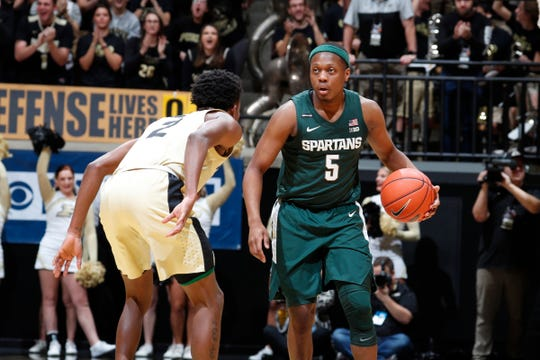 Michigan State guard Cassius Winston is guarded by Purdue guard Eric Hunter Jr. during the first half on Sunday, Jan. 12, 2020, in West Lafayette, Ind.