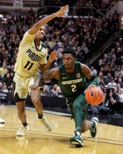 Michigan State guard Rocket Watts drives on Purdue guard Isaiah Thompson during the first half on Sunday, Jan. 12, 2020, in West Lafayette, Ind.