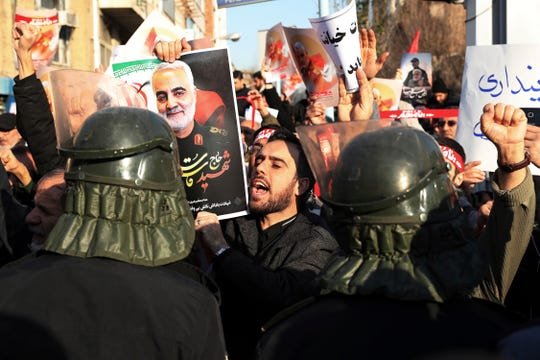 Riot police in black uniforms and helmets earlier massed in Vali-e Asr Square, at Tehran University and other landmarks.
