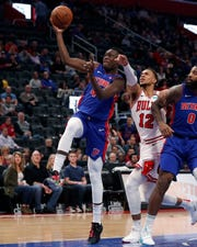 Detroit Pistons forward Sekou Doumbouya (45) makes a layup as Chicago Bulls forward Daniel Gafford (12) reaches in during the first half.