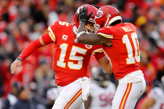 Kansas City Chiefs quarterback Patrick Mahomes celebrates with wide receiver Tyreek Hill.