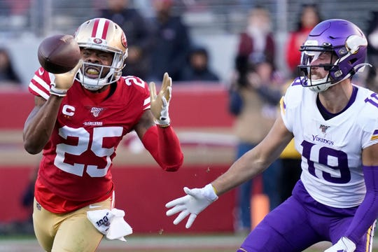 San Francisco 49ers cornerback Richard Sherman (25) intercepts a pass in front of Minnesota Vikings wide receiver Adam Thielen (19) during the second half.