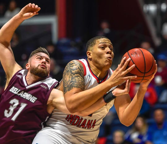 University of Southern Indiana's Tyler Dancy (31) pulls down a offensive rebound under pressure from Bellarmine's Parker Chitty (31) as the University of Southern Indiana Screaming Eagles play the Bellarmine Knights in a double header at Screaming Eagle Arena Saturday, January 11, 2020.