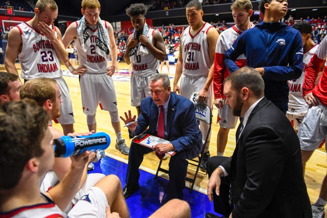 University of Southern Indiana head coach Rodney Watson talks to his team during a late game timeout as the University of Southern Indiana Screaming Eagles play the Bellarmine Knights in a double header at Screaming Eagle Arena Saturday, January 11, 2020.
