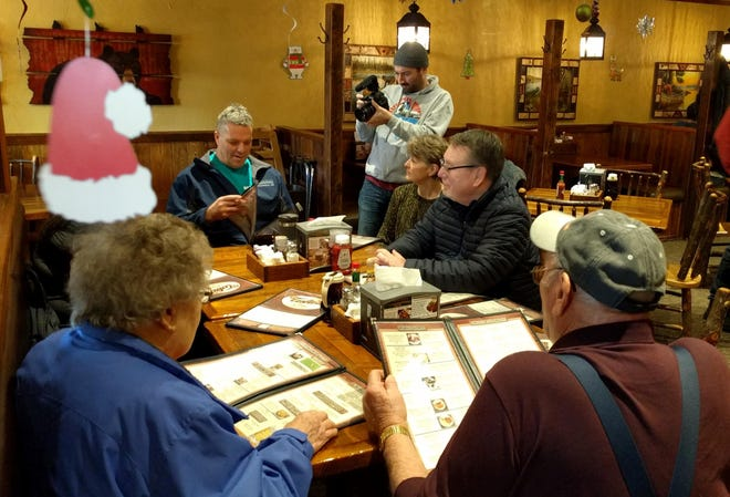 Mike Hirn, at the head of the table, went out to eat at Tula's Cafe in Minoqua on Dec. 18, 2018, the day he was released from prison.
