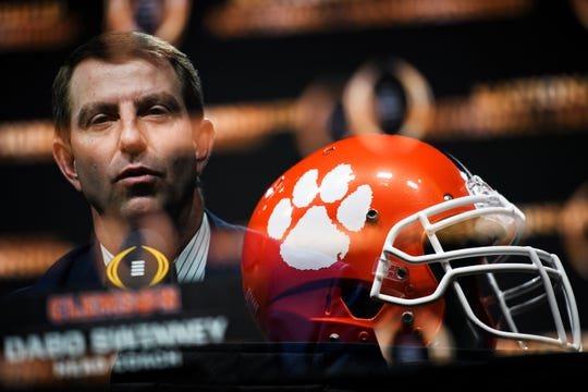 Clemson Head Coach Dabo Swinney speaks in this double exposure photograph during a press conference ahead of the College Football National Championship game Sunday, Jan. 12, 2020.