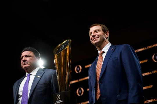 Clemson Head Coach Dabo Swinney and LSU head coach Ed Orgeron pose for a photo during a press conference ahead of the College Football National Championship game Sunday, Jan. 12, 2020.
