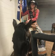 Miss Teen Rodeo Montana Rebecca Stroh and her trusty steed pauses during an event Saturday at the 41st annual Montana Pro Rodeo Circuit Finals.