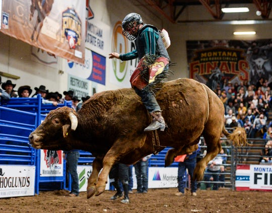 Gerald Eash of Trego, Mont., competes in the bull riding event during the Montana Pro Rodeo Circuit Finals in the Four Seasons Arena Friday evening.