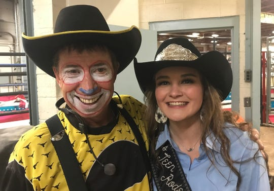 Veteran Canadian rodeo clown Denny Halstead and outgoing Miss Teen Rodeo Montana Rebecca Stroh of Chinook share a Kodak moment. During Saturday's second go-round, Stroh -- a wrestler at Chinook -- scored a pair of two-point takedowns against Halstead. Stroh won by unanimous decision.