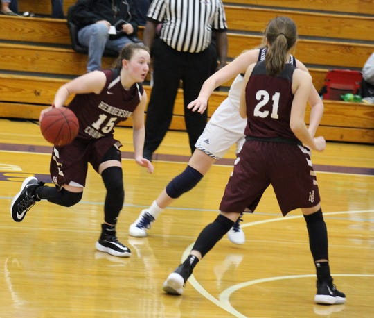 Henderson County's Sadie Wurth drives toward the basket as teammate Graci Risley sets a screen during Saturday's game against Elizabethtown in the Bluegrass Cellular New Year's Classic at Central Hardin High School.