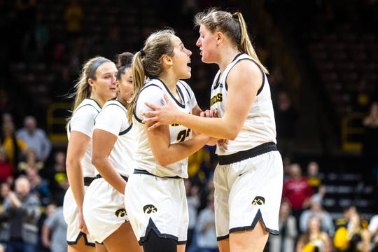 Iowa guard Kathleen Doyle (22) huddles with teammate Monika Czinano, right, during a game against Indiana on Jan. 12 at Carver-Hawkeye Arena in Iowa City.
