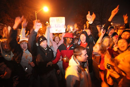 In a Jan. 12, 2010 photograph, freshman Kacie Wilson, with sign, is among the students showing their displeasure with Lane Kiffin's resignation as coach of the University of Tennessee football team. Kiffin took the coaching job at Southern California  after just one season at Tennessee. (Adam Brimer/News Sentinel)