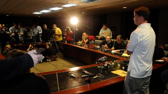 Former UT head football coach Lane Kiffin talks to media following his resignation Tuesday, Jan 12, 2010.