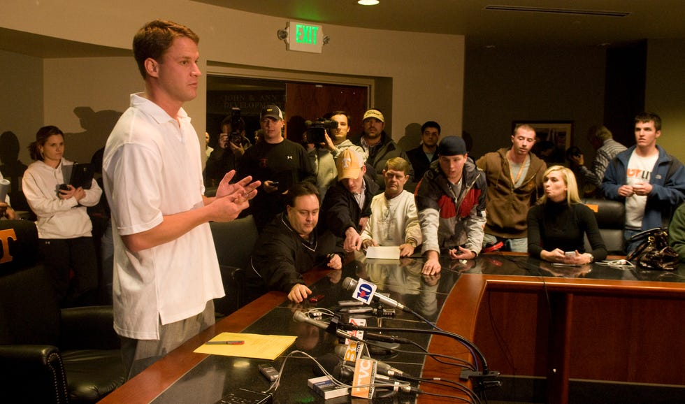 Lane Kiffin speaks to a crowd of reporters Tuesday night to announce his resignation on Tuesday, Jan. 12, 2010.