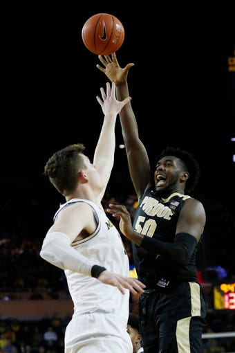 Jan 9, 2020; Ann Arbor, Michigan, USA; Purdue Boilermakers forward Trevion Williams (50) shoots the ball over Michigan Wolverines center Jon Teske (15) in the second half at Crisler Center. Mandatory Credit: Rick Osentoski-USA TODAY Sports