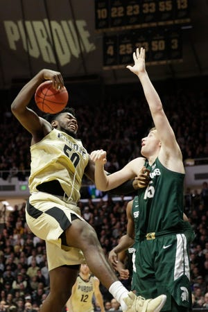 Purdue forward Trevion Williams (50) pulls down the rebound against Michigan State forward Thomas Kithier (15) during the first half of a NCAA men's basketball game, Sunday, Jan. 12, 2020 at Mackey Arena in West Lafayette.