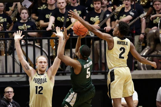 Purdue guard Eric Hunter Jr. (2) goes behind Michigan State guard Cassius Winston (5) to block Michigan State guard Cassius Winston (5)'s shot during the second half of a NCAA men's basketball game, Sunday, Jan. 12, 2020 at Mackey Arena in West Lafayette.