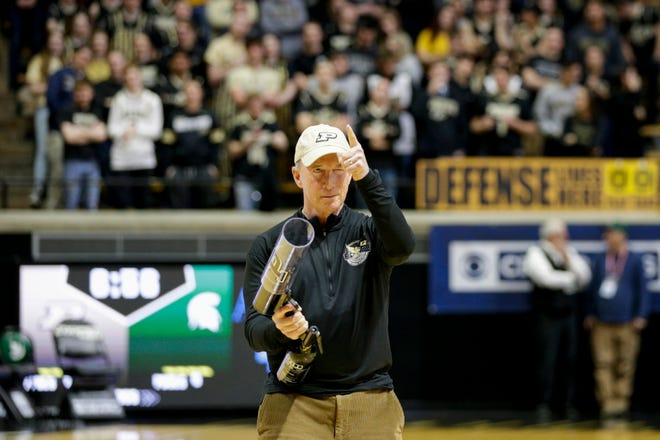Purdue president Mitch Daniels points into the student section before firing a T-shirt cannon before a men's basketball game Jan. 12 between Purdue and Michigan State at Mackey Arena in West Lafayette.
