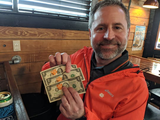 Clemson fan Jeff Leonard shows off his Clemson $2 bills at The Rusty Nail on Sunday, Jan. 12, 2020.