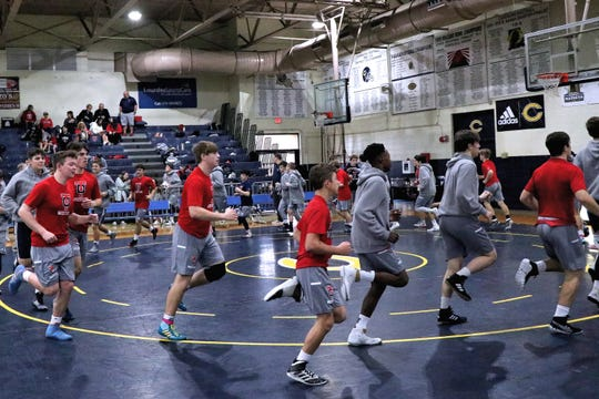 The Teurlings Catholic wrestling team warms up before the annual Greg Lavergne Parish Duals Championships is held at Carencro High School Saturday, Jan. 11, 2020.
