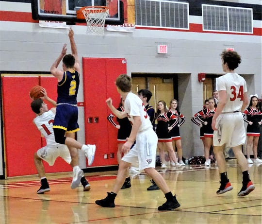 Fairfield Union's Sam Bernard gets Bloom-Carroll's Otto Kuhns up in the air before he takes a shot during Friday's MSL-Buckeye Division game. The Falcons won, 40-38.