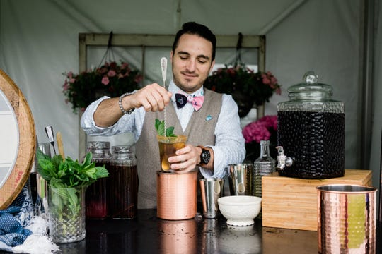 Mocktail Project founder Jesse Hawkins makes a mocktail at the 2019 Kentucky Derby