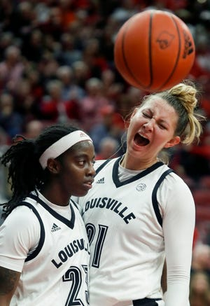 Louisville's Jazmine Jones and Kylee Shook celebrate Jones making a basket and drawing the foul against Wake Forest on Jan. 12, 2020.