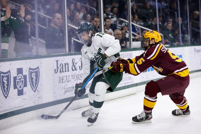 Michigan State forward Nico Muller gathers the puck behind the Minnesota net in Friday's Big Ten game against Minnesota at Munn Ice Arena. After winning 4-1 Friday, the Spartans dropped Saturday's contest to Minnesota 2-0