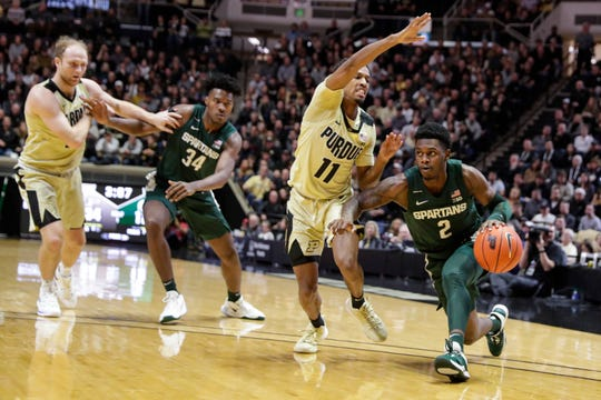 Michigan State guard Rocket Watts (2) drives on Purdue guard Isaiah Thompson (11) during the first half of an NCAA college basketball game in West Lafayette, Ind., Sunday, Jan. 12, 2020. (AP Photo/Michael Conroy)