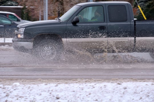 A driver in St. Johns encounters slushy roads on Sunday afternoon, Jan. 12, 2020.