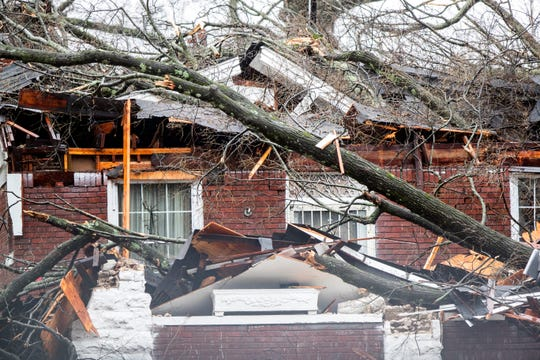 A storm damaged home on North Parkway cause by heavy rain and high winds uprooting a large tree on Saturday Jan. 11, 2020.