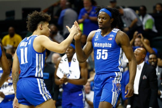Memphis Tigers forward Precious Achiuwa high-fives teammate Lester Quinones after scoring against South Florida during their game at the Yuengling Center in Tampa, Fla. On Sunday, Jan. 12, 2020.