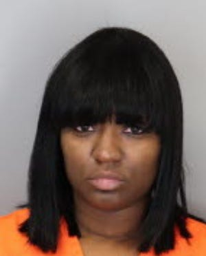 Cadarius Davis, 32, was charged with vehicular assault and several misdemeanors after striking and injuring an officer with her vehicle on Jan. 12.  The officer was parked in a squad car at the time of the crash. Davis had two children in her vehicle and appeared intoxicated, according to the affidavit.