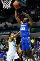 Memphis Tigers forward Precious Achiuwa dunks the ball over South Florida forward Michael Durr during their game at the Yuengling Center in Tampa, Fla. On Sunday, Jan. 12, 2020.