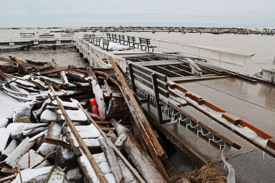 Debris is piled up after a recent storm pushed water ashore and damaged piers at South Shore Yacht Club in Bay View.