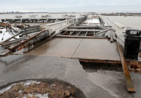 High winds from storms pushed water ashore and damaged piers at the South Shore Yacht Club in Milwaukee.
