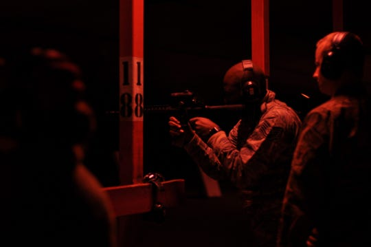 Technical Sgt. Marcus Johnson, 908th Security Forces Squadron defender, shoots his M4 carbine with night vision optics Nov. 2, 2019, in the firing bay at Maxwell AFB, Alabama. The SFS defenders train for multiple types of scenarios so that they are prepared to fight in any type of situation and anywhere at a moment's notice.