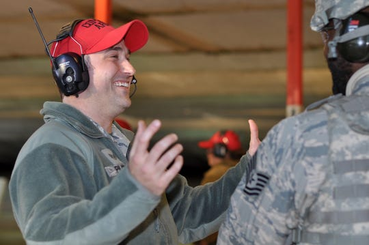 Staff Sgt. Jonathan Pilgrim, 908th Security Forces Squadron Combat Arms instructor, laughs inside the firing bay at Maxwell AFB, Alabama. Pilgrim has been a CA instructor since first joining the U.S. Air Force in 2011.