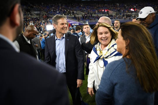 Tennessee Gov. Bill Lee and his wife, Maria, far right, chat with Tennessee Titans owner Amy Adams Strunk before the NFL Divisional Playoff game against the Baltimore Ravens at M&T Bank Stadium Saturday, Jan. 11, 2020 in Baltimore, Md.