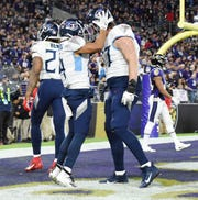 Tennessee Titans wide receiver Kalif Raymond (14) celebrates his touchdown with offensive tackle Taylor Lewan (77) during the second quarter of an NFL Divisional Playoff game against the Baltimore Ravens at M&T Bank Stadium Saturday, Jan. 11, 2020 in Baltimore, Md.