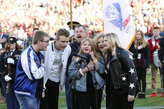 "Rockland Road sings ""The Star-Spangled Banner"" at the Music City Bowl in Nashville on Dec. 30."