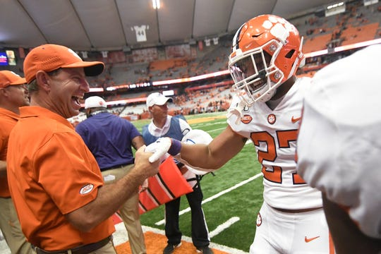 Clemson's Chez Mellusi, a Naples High graduate, celebrates a fourth-quarter touchdown against Syracuse with Clemson coach Dabo Swinney during an NCAA college football game Saturday, Sept. 14, 2019, in Syracuse, N.Y.
