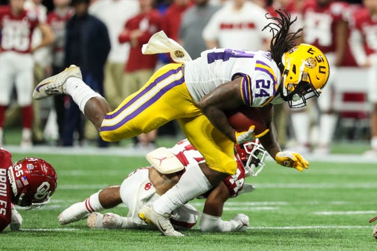 LSU Tigers running back Chris Curry (24), a Lehigh graduate, runs the ball during the first quarter of the 2019 Peach Bowl college football playoff semifinal game against the Oklahoma Sooners at Mercedes-Benz Stadium.