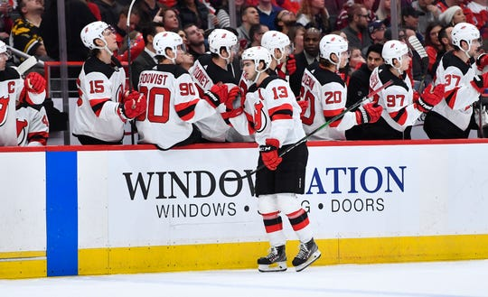 Jan 11, 2020; Washington, District of Columbia, USA; New Jersey Devils center Nico Hischier (13) is congratulated by teammates after scoring against the Washington Capitals during the first period at Capital One Arena.