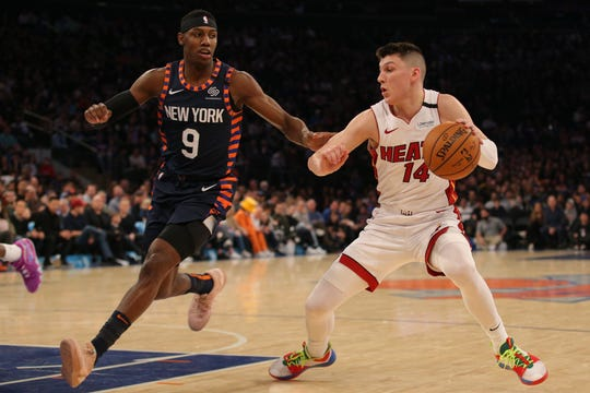 Jan 12, 2020; New York, New York, USA; Miami Heat shooting guard Tyler Herro (14) controls the ball against New York Knicks shooting guard RJ Barrett (9) during the second quarter at Madison Square Garden. Mandatory Credit: Brad Penner-USA TODAY Sports
